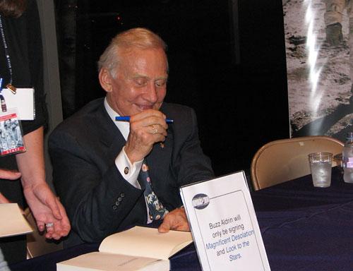 Buzz Aldrin signing books