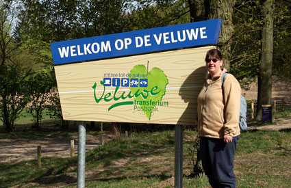 Amy at Welcome to the Veluwe sign