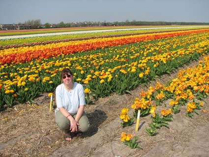 Amy by flower fields in Noord Holland